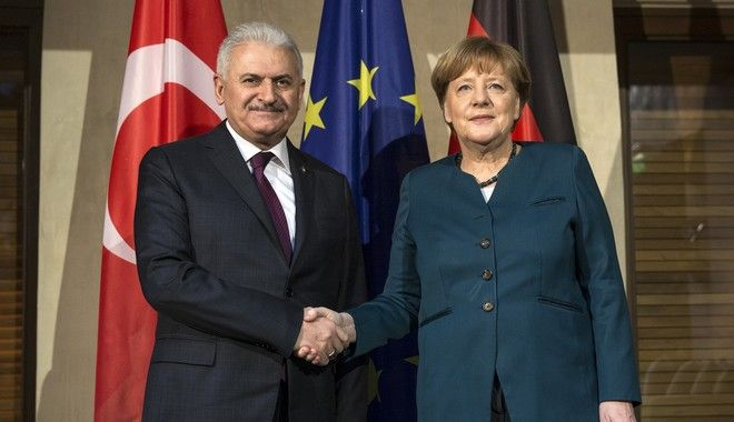 German Chancellor Angela Merkel, right, poses for a picture with Turkish Prime Minister Binali Yildirim prior to a bilateral meeting during the 53rd Munich Security Conference in Munich, Germany, Saturday, Feb. 18, 2017. (Prime Minister's Press Service, Pool Photo via AP)