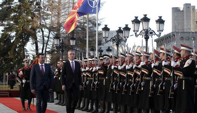 NATO Secretary General Jens Stoltenberg, second from left, accompanied by Macedonian Prime Minister Zoran Zaev, left, inspects an honor guard squad upon his arrival at the Government building in Skopje, Macedonia, Thursday, Jan. 18, 2018. NATO's secretary-general urged Macedonia on Thursday to solve its 25-year-old name dispute with alliance member Greece and proceed with wide-ranging reforms if it wants its membership bid to succeed. (AP Photo/Boris Grdanoski)