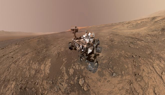 This composite image made from a series of Jan. 23, 2018 photos shows a self-portrait of NASA's Curiosity Mars rover on Vera Rubin Ridge. The rover's arm which held the camera was positioned out of each of the dozens of shots which make up the mosaic. (NASA/JPL-Caltech/MSSS via AP)