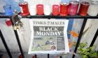 Candles, notes and paper cuttings lie next to the Love Monument in St. Julian, Malta, Tuesday Oct. 17, 2017 the day after the killing of journalist Daphne Caruana Galizia. Daphne Caruana Galizia, the Maltese investigative journalist who exposed the island nation's links to offshore tax havens through the leaked Panama Papers, was killed Monday when a bomb exploded in her car. (AP Photo/ Rene Rossignaud)