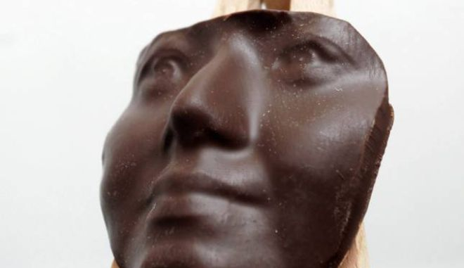 A chocolate face which has been printed using the world's first ever chocolate 3D printer, at the Innovation Centre at the Exeter University in Devon. Chocoholics who are still not sick of the choccies this Christmas can now get their face made out of their fave treat  - with the world's first 3D CHOCOLATE printer. See swns story SWCHOC.  A firm called 'Choc Edge' has designed the state-of-the-art machine which allows users to build any 2D or 3D shape out of delicious Belgian chocolate. Customers can send an image of themselves through the company's website and the machine creates a thick layered portrait - like a mask - for between £50 to £80. There is also a cheaper version - the machine will produce a 2D portrait on edible rice paper for £24.99. The company was set up in 2011 by Dr Liang Hao of the University of Exeter in Devon and has since sold the machines to companies across the globe. The unique machine - Choc Creator - works by squirting out chocolate and, via computer instructions, allowing the user to build any shape they like out of the food. The innovative machine, which can print layers of dark, milk or white chocolate onto any flat surface including cakes and biscuits, creates a number of versatile shapes, designs and logos.