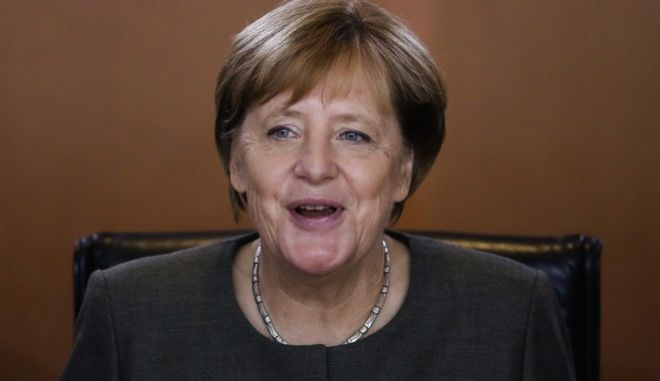 German Chancellor Angela Merkel smiles as she attends the weekly cabinet meeting of the German government at the chancellery in Berlin, Wednesday, Sept. 13, 2017. (AP Photo/Markus Schreiber)