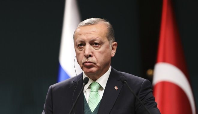 Turkey's President Recep Tayyip Erdogan, listens during a joint news statement with Russia's President Vladimir Putin, following their meeting at the Presidential Palace in Ankara, Monday, Dec. 11, 2017. The two men met Monday evening to discuss developments in Syria and the Middle East, as well as bilateral relations, according to the Turkish President's office. (AP Photo/Burhan Ozbilici)