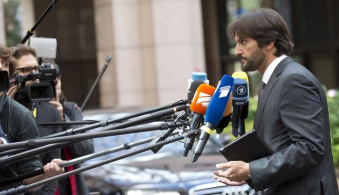 Slovakian Interior Minister Robert Kalinak speaks with the media as he arrives for a meeting of EU justice and interior ministers at the EU Council building in Brussels on Monday, Sept. 14, 2015. EU ministers on Monday will discuss the current migration crisis. (AP Photo/Virginia Mayo)