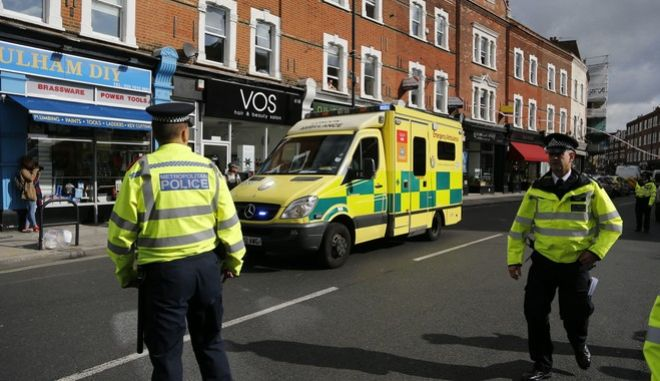 """Police and an ambulance stand near Parsons Green subway station in London, Friday, Sept. 15, 2017. London's Metropolitan Police and ambulance services are confirming they are at the scene of """"an incident"""" at the Parsons Green subway station in the southwest of the capital. (AP Photo/Frank Augstein)"""