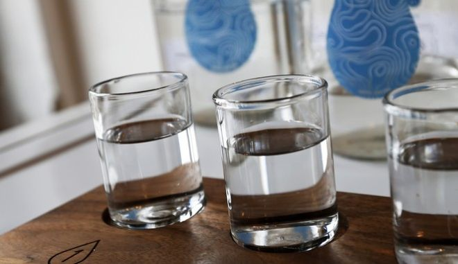 In this March 16, 2016, photo, glasses of water are shown in the building where Colin Kloecker and his wife, Shanai Matteson, are preparing to open a storefront Water Bar in northeast Minneapolis, a taproom serving pints of free city water plus limited-edition pours from other communities. (AP Photo/Jim Mone)