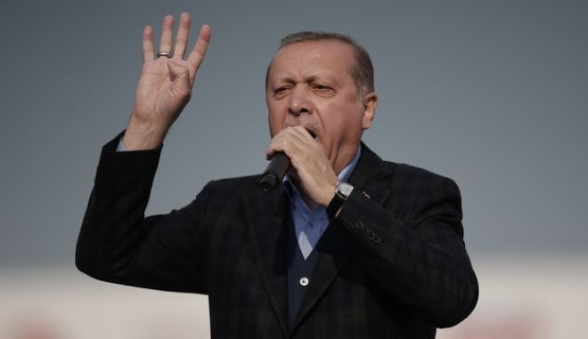 Turkey's President Recep Tayyip Erdogan addresses his supporters during a referendum rally in Istanbul, Saturday, April 8, 2017. Turkey is heading to a contentious April 16 referendum on constitutional reforms to expand Erdogan's powers.(AP Photo/Emrah Gurel)