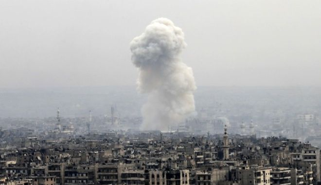 Smoke rises following a Syrian government air strike on rebel positions, in eastern Aleppo, Syria, Monday, Dec. 5, 2016.  (AP Photo/Hassan Ammar, File)