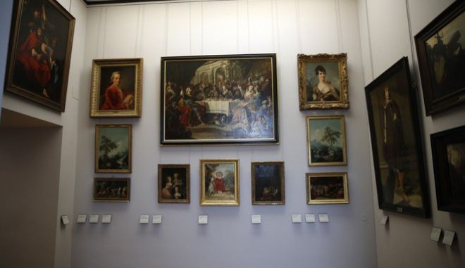 Paintings looted by Nazis during World War II, are on display at the Louvre museum, in Paris, Tuesday, Jan. 30, 2018. In a move aimed at returning work of art looted by Nazis during World War II, the Louvre museum has opened two showrooms with 31 paintings on display which can be claimed by their legitimate owners. (AP Photo/Christophe Ena)