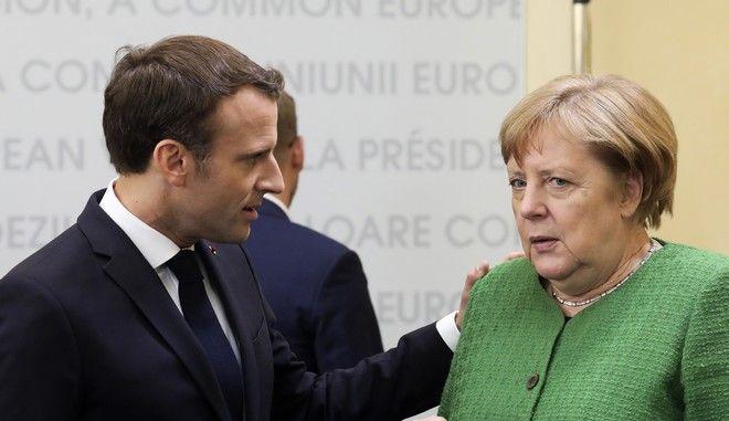 Η Γερμανίδα καγκελάριος Άνγκελα Μέρκελ και ο Γάλλος πρόεδρος Εμανουέλ Μακρόν σε σύνοδο της ΕΕ στη Ρουμανία