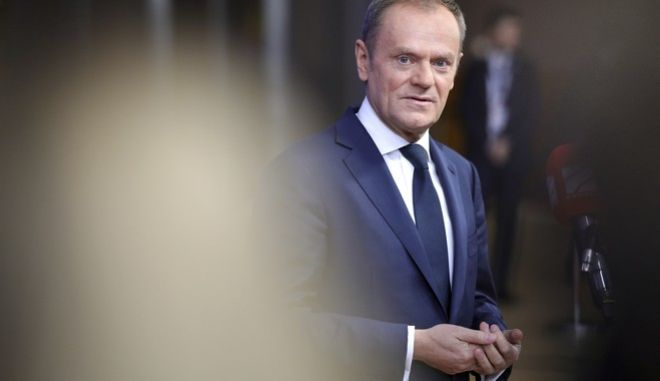 European Council President Donald Tusk speaks with journalists as he arrives for an EU summit at the Europa building in Brussels on Thursday, Dec. 14, 2017. European Union leaders are gathering in Brussels and are set to move Brexit talks into a new phase as pressure mounts on Prime Minister Theresa May over her plans to take Britain out of the 28-nation bloc. (AP Photo/Olivier Matthys)