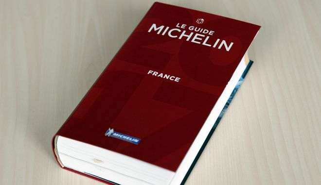FILE - In this file photo dated Thursday, Feb.9, 2017, The Michelin Guide 2017 is pictured in Paris, France. The Michelin guide said in a statement Tuesday Jan. 30, 2018, it has allowed chef Sebastien Bras to withdraw his Le Suquet three-star restaurant in southern France, from its 2018 edition because of the huge pressure involved. (AP Photo/Christophe Ena, FILE)