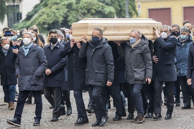 His former teammates in the winning World Cup team Marco Tardelli, Antonio Cabrini, Gianpiero Marini, Alessandro Altobelli carry the coffin of Paolo Rossi as it leaves the church after his funeral service, in Vicenza, Italy, Saturday, Dec. 12, 2020. Paolo Rossi, who led Italy to the 1982 World Cup title and later worked as a soccer commentator in his home country, died at the age of 64. (Paola Garbuio/LaPresse via AP)