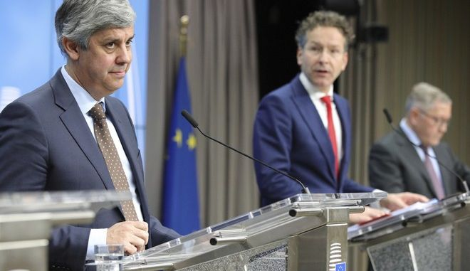 Portugal's Finance Minister Mario Centeno, left, and president of the eurogroup Jeroen Dijsselbloem, right, address a media conference after a meeting of eurozone finance ministers at the Europa building in Brussels on Monday, Dec. 4, 2017. Eurozone finance ministers met Monday to elect a new president for the club of 19 nations that share the euro currency. (AP Photo/Olivier Matthys)