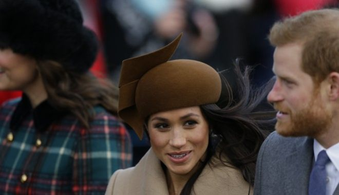 Prince Harry and his fiancee Meghan Markle arrive to attend their traditional Christmas Day church service, at St. Mary Magdalene Church in Sandringham, England, Monday, Dec. 25, 2017. (AP Photo/Alastair Grant)