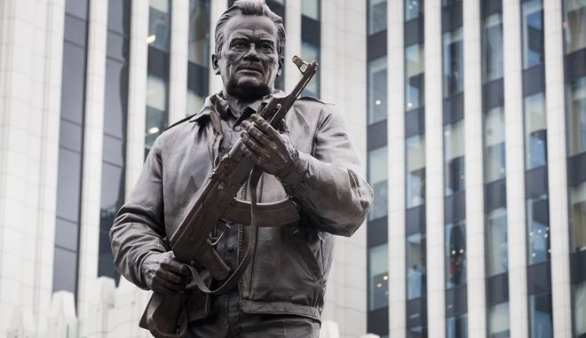 A new monument to Russian firearm designer Mikhail Kalashnikov is unveiled during an official ceremony in Moscow, Russia, Tuesday, Sept. 19, 2017. Kalashnikov, who died in 2013 at age 94 in the city of Izhevsk, has received accolades as the creator of the AK-47 assault rifle. By some estimates, the AK-47 and its versions account for about one-fifth of the worlds firearms. (AP Photo/Pavel Golovkin)