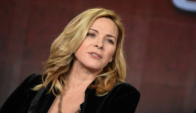 """Kim Cattrall speaks on stage during the """"Shakespeare Uncovered"""" panel at the PBS 2015 Winter TCA on Tuesday, Jan. 20, 2015, in Pasadena, Calif. (Photo by Richard Shotwell/Invision/AP)"""