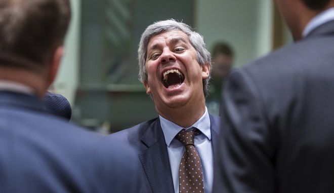 Portugal's Finance Minister Mario Centeno laughs, during a meeting of eurozone finance ministers at the Europa building in Brussels on Monday, Dec. 4, 2017. The Eurogroup on Monday elected Portugal's Finance Minister Mario Centeno as the new president of the Eurogroup. (AP Photo/Geert Vanden Wijngaert)