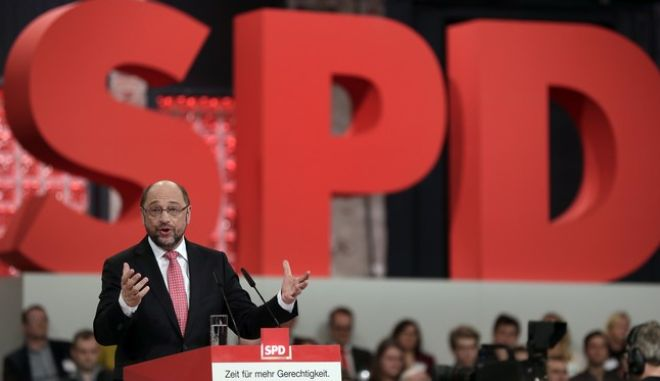 Designated chairman and top candidate for the upcoming general election Martin Schulz, speaks during an extraordinary convention of the German Social Democratic party, SPD, in Berlin, Germany, Sunday, March 19, 2017. (AP Photo/Michael Sohn)