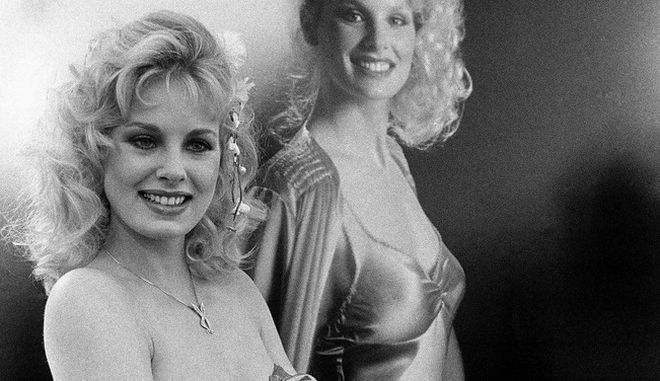 """Actress Dorothy Stratten, 20, of Vancouver, British Columbia poses in front of a huge poster of herself  Apr. 29, 1980 in Los Angeles as she was named the 1980 """"Playboy"""" Playmate of the year. She will be featured on the cover of June """"Playboy"""" and in an additional 17 pages of the issue. (AP Photo/Randy Rasmussen)"""