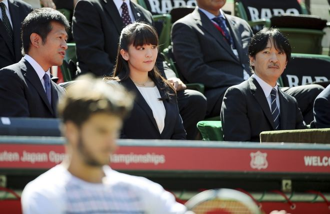 Japan's Prince Akishino, right, and his daughter Princess Mako, center, watch Feliciano Lopez of Spain, bottom left,  during his singles match against Joao Sousa of Portugal at the Japan Open men's tennis tournament in Tokyo, Wednesday, Oct. 7, 2015. (AP Photo/Eugene Hoshiko)