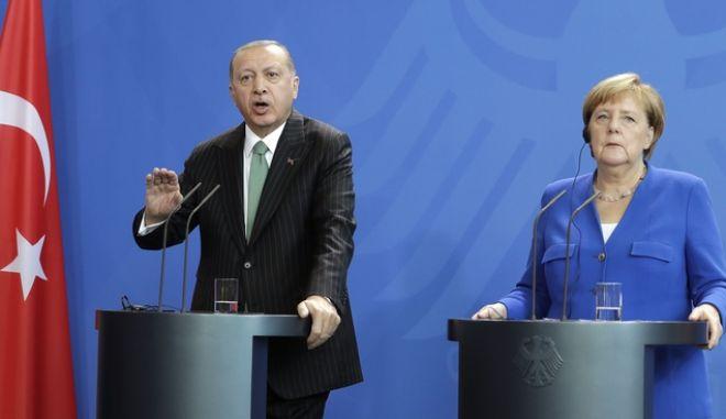 Ο Τούρκος πρόεδρος Ταγίπ Ερντογάν και η Γερμανίδα καγκελάριος Άνγκελα Μέρκελ