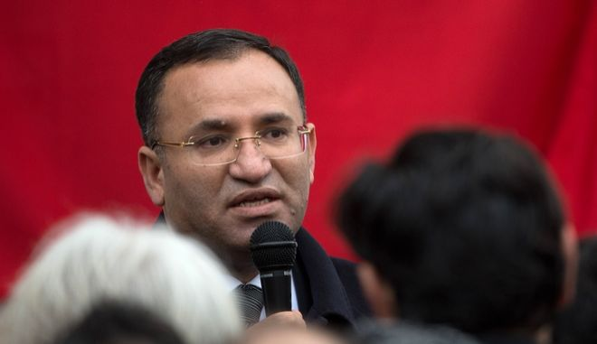 Turkish Vice President Bekir Bozdag speaks during  a mmorial service for the victims of  a deadly fire in Backnang, southern Germany. Tuesday March 12, 2013.  An early-morning fire Sunday at an apartment building in Backnang,  left eight people of Turkish origin dead, seven of them children. (AP Photo/dpa,Marijan Murat)