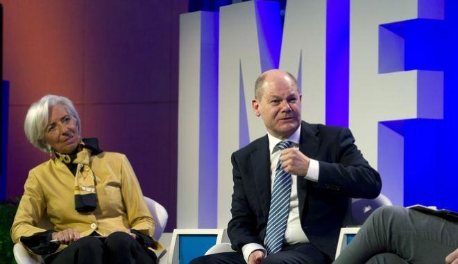 Ο γερμανός υπ. Οικονομικών, Όλαφ Σολτς και η διευθύντρια του ΔΝΤ, Κριστίν Λαγκάρντ