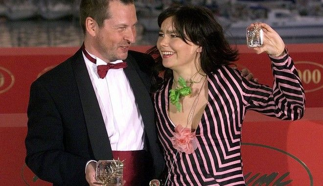 Icelandic singer/actress Bjork, right, raises her best actress award, with Danish director Lars Von Trier, who holds the Golden Palm award of the 53rd International Film Festival in Cannes, for their film