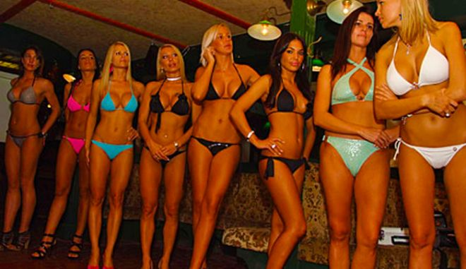 """Judges are to give their verdict on a bizarre beauty contest with a difference - only women with fake boobs and facelifts can take part. The Miss Plastic contest in Hungary features patients of leading cosmetic surgeons showing off everything from boob jobs and liposuction to hair transplants. Judges - who will award prizes to the surgeons for their handiwork - not only have to study the contestants' vital statistics but their medical records too. But the tension of the contest - which begins in Budapest on Friday (oct 9) - has led to a series of back stage bust-ups as contestants gear up for the final face off. """"I'm suing my hair supplier because what they supplied caught fire while it was being dyed. Luckily before it had been fitted to my head,"""" said one contestant, Alexandra Horvath. Organisers claim the event allows the contestants - aged from 19 to 38 - to celebrate the beautiful bodies they helped to create."""