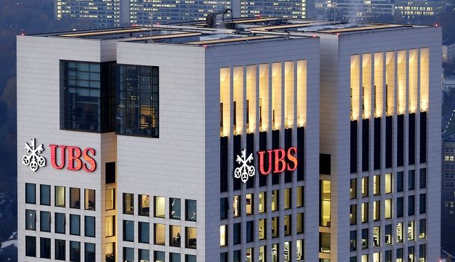 FILE - In this  Tuesday, Nov. 13, 2012, file photo, the German headquarter of Swiss UBS bank is photographed in Frankfurt, Germany. UBS AG reports quarterly results before the market open on Tuesday, Oct. 29, 2013. (AP Photo/Michael Probst, File)