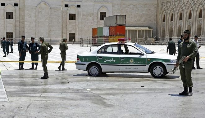 Police officers control the scene, around of shrine of late Iranian revolutionary founder Ayatollah Khomeini, after an assault of several attackers in Tehran, just outside Tehran, Iran, Wednesday, June 7, 2017. (AP Photo/Ebrahim Noroozi)