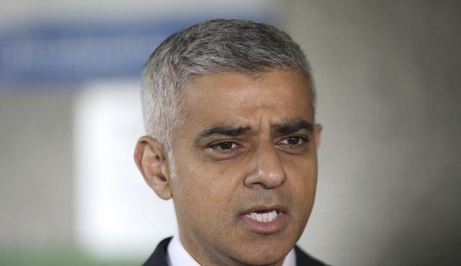 Mayor of London Sadiq Khan speaks to the media as he joined London Ambulance workers in observing a minute's silence at the London Ambulance Service headquarters at Waterloo, central London, in honour of the London Bridge terror attack victims, Tuesday June 6, 2017. A new search was underway Tuesday in a neighborhood near the home of two of the London Bridge attackers, hours after police said they had freed everyone detained in the wake of the rampage that left several dead and dozens wounded. (Yui Mok/PA via AP)