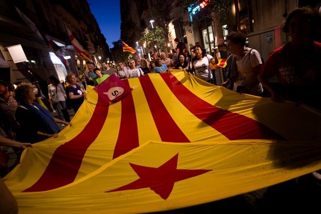 People demonstrate carrying esteladas or independence flags ahead of the Catalan National Day in Barcelona, Spain, Sunday Sept. 10, 2017. Hundred of thousands of people are expected to demonstrate in Barcelona to call for the creation of a new Mediterranean nation, as they celebrate the Catalan National Day holiday. (AP Photo/Emilio Morenatti)