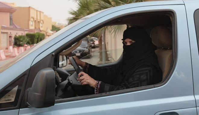 Aziza Yousef drives a car in Riyadh, Saudi Arabia, Saturday, March 29, 2014, as part of a campaign to defy Saudi Arabia's ban on women driving. In the six months since Saudi activists renewed calls to defy the kingdom's ban on female drivers, small numbers of women have gotten behind the wheel almost daily in what has become the country's longest such campaign. (AP Photo/Hasan Jamali)