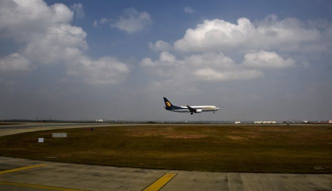 FILE- In this Dec. 25, 2017 file photo, a Jet Airways aircraft lands at the Kempegowda International Airport in Bangalore, India. India's Jet Airways says it has ordered an investigation into reports that a senior pilot slapped a female co-pilot in the cockpit during a London to Mumbai flight this week. (AP Photo/R S Iyer, File)