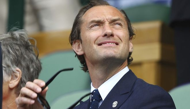British actor Jude Law take his seat in the Royal Box for a Men's Singles semifinal match on day eleven at the Wimbledon Tennis Championships in London, Friday, July 14, 2017.. (Gareth Fuller/Pool Photo via AP)
