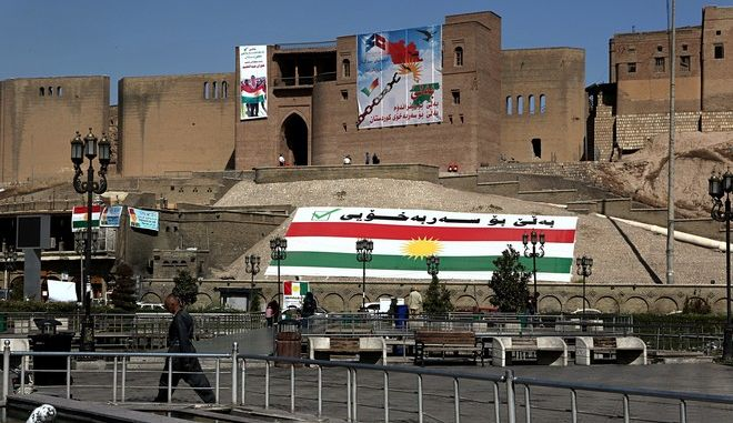 Kurdish flags and pro-independence items hang on Irbil's citadel in central Irbil, 217 miles (350 kilometers) north of Baghdad, Iraq, Sunday, Sept. 24, 2017. Iraq's Kurdish region will vote on Monday's referendum for Kurdish independence, a vote dismissed as illegal and destabilising by the central government and the international community. (AP Photo/Khalid Mohammed)