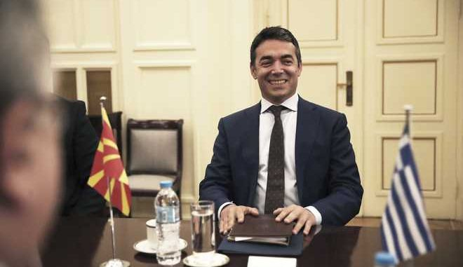Macedonian Foreign Minister Nikola Dimitrov, gestures during his meeting with Greek Foreign Minister Nikos Kotzias in Athens, Wednesday, June 14, 2017. Dimitrov is in Greece on a one day official visit. (AP Photo/Petros Giannakouris)