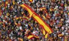 """People wave Spanish national flags as thousands packed the central Cibeles square to in Madrid, Spain, Saturday, Sept. 30, 2017. Thousands of pro-Spanish unity supporters donning Spanish flags have rallied in a central Madrid plaza to protest the Catalan regional government's drive to separate from Spain. Writing on one of the flags reads: """"Long live the Unity of Spain"""". (AP Photo/Paul White)"""