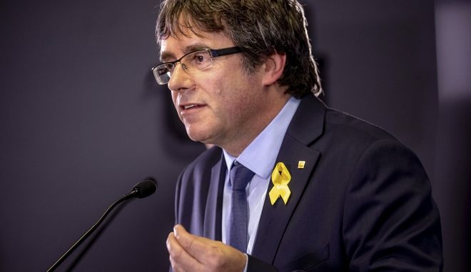 Former Catalan leader Carles Puigdemont, right, speaks during a press conference with current regional president of Catalonia Quim Torra after a meeting with government ministers and ministers in exile at the Government Delegation of Catalonia to the European Union in Brussels on Saturday, July 28, 2018. (AP Photo/Olivier Matthys)