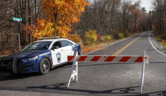 CRESCO, PA - OCTOBER 31: A Pocono Police car sits on the route to the hangar where Eric Matthew was captured on Thursday night, on October 31, 2014 in Cresco, Pennsylvania. Frein, a suspected cop killer, was taken into custody from a Pennsylvania airport hangar after a seven-week manhunt. (Photo by Kena Betancur/Getty Images)