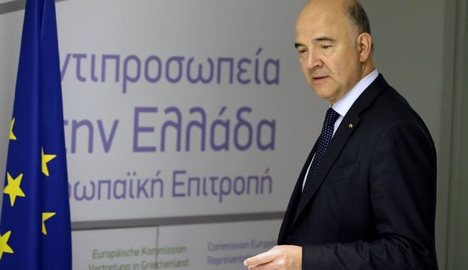 European Commissioner for Economy Pierre Moscovici arrives for a news conference in Athens, Tuesday, July 25, 2017. Greece is poised to tap international bond markets for the first time in three years in a move the government hopes will signal the country is ready to emerge from its bailout era. (AP Photo/Thanassis Stavrakis)