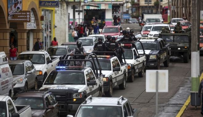 Police and army patrol the streets of Acayucan, Veracruz state, Mexico, Tuesday July 11 2017. According to a statement from the state prosecutor's office, Honduran video-journalist Edwin Rivera Paz was shot to death Sunday in Acayucan. He had sought refugee status in Mexico after he fled Honduras when his colleague Igor Padilla was killed. In May, Mexico recorded its highest monthly murder total in at least 20 years.(AP Photo/Felix Marquez)