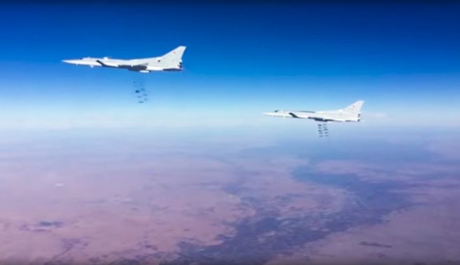 This photo provided by the Russian Defense Ministry Press Service shows Russian air force Tu-22M3 bombers strike the Islamic State group wldtargets in Syria on Tuesday, Jan. 24, 2017. The mission, the third such bombing raid in four days, targeted the Islamic State group around Deir el-Zour in eastern Syria where the Islamic State group has launched an offensive against Syrian government forces. (Russian Defense Ministry Press Service Photo via AP)
