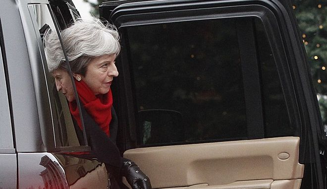 British Prime Minister Theresa May comes to the meeting with Polish Prime Minister Mateusz Morawiecki in Warsaw, Poland, Thursday, Dec. 21, 2017. May's visit to the Polish capital comes as a politically turbulent time for both countries, as Britain prepares to leave the European Union and Poland finds itself in a escalating standoff with the bloc over a bitterly criticized overhaul of its judicial system. (AP Photo/Czarek Sokolowski)