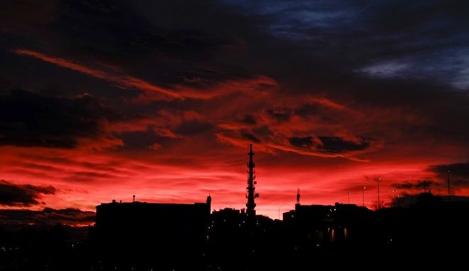 The silhouette of a television tower contrasts with the sky painted with deep colour as the sun sets during a winter's evening, in Pamplona, northern Spain, Wednesday, Jan. 3, 2018. (AP Photo/Alvaro Barrientos)