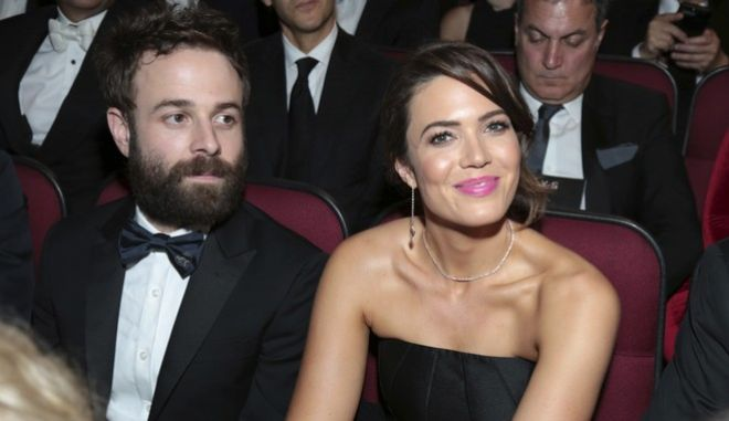 Taylor Goldsmith, left, and Mandy Moore appear in the audience at the 69th Primetime Emmy Awards on Sunday, Sept. 17, 2017, at the Microsoft Theater in Los Angeles. (Photo by Alex Berliner/Invision for the Television Academy/AP Images)