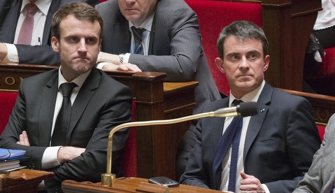 French prime  minister Manuel Vals, right, and French Economic  minister Emmanuel Macron attend  a session of the French National Assembly in Paris, Tuesday, Feb. 17, 2015. Frances Parliament votes on a hotly debated and potentially landmark bill that loosens up some labor rules to boost hiring and notably allows stores to open Sundays and evenings for tourists. Leftists and labor unions say the bill is too pro-business, but the Socialist government says it's time to face modern economic realities. (AP Photo/Jacques Brinon)