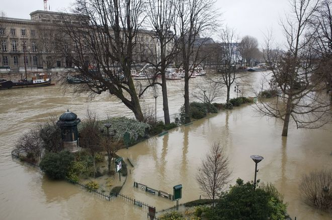 A flooded public park is pictured in Paris, Tuesday, Jan. 23, 2018. The Seine River has overflowed its banks in Paris, prompting authorities to close several roads and cancel boat cruises. Paris City Hall closed roads along the shores of the Seine from the east of the capital to the area around the Eiffel Tower in the west as water levels rose at least 3.3 meters (nearly 11 feet) above the normal level. (AP Photo/Thibault Camus)